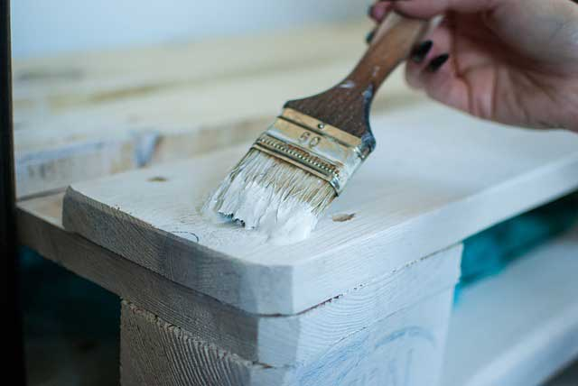 how to paint pressure treated wood